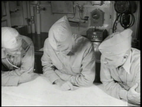 United States Navy Fleet Admiral William 'Bull' Halsey Jr aka 'Bill' other two naval officers looking over map inside ship World War II WWII Pacific...