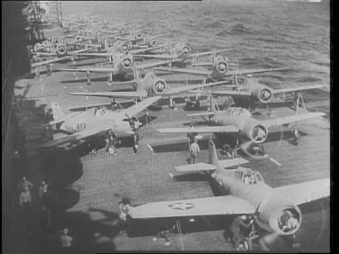 united states navy in the pacific ready for action against the japanese / planes a carrier deck / reporter joe rucker shown on deck of aircraft... - pacific war video stock e b–roll