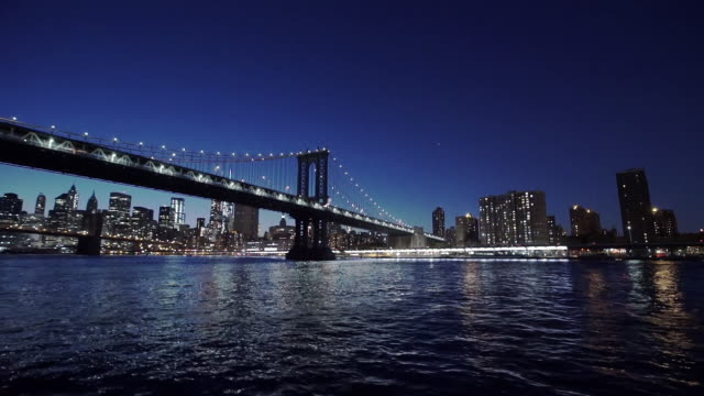 united states, new york, new york city, manhattan bridge illuminated at night - east river stock videos & royalty-free footage