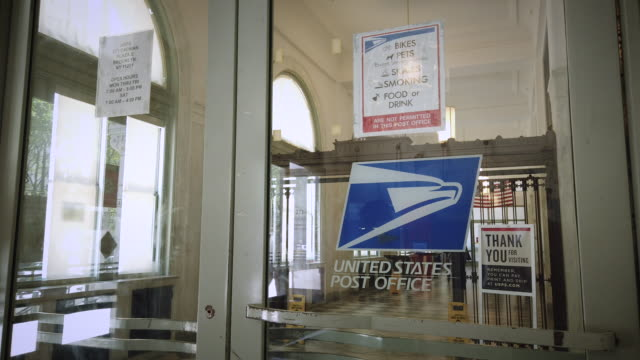 united states postal office entrance with logo. filmed at 271 cadman plaza e ste 2, brooklyn, ny 11201. - united states postal service stock videos & royalty-free footage