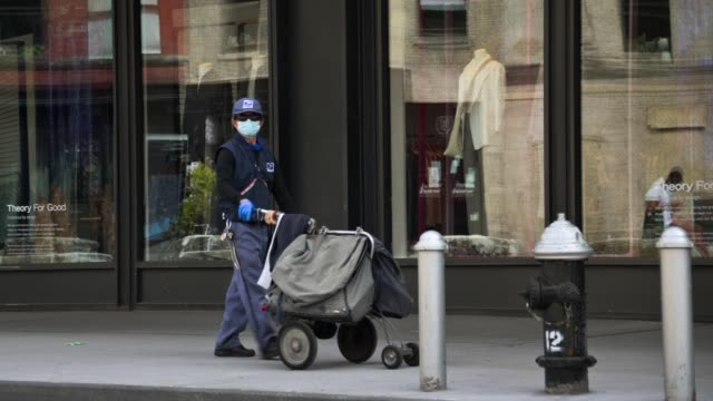 united states postal service worker wearing a protective mask delivers mail in the meatpacking district during the coronavirus pandemic on may 14,... - united states postal service stock videos & royalty-free footage