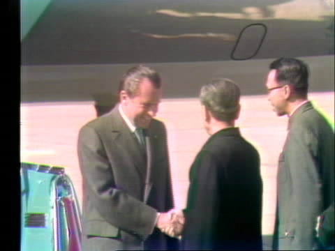 united states president and first lady richard and pat nixon deplane in peking, china and are welcomed by chinese prime minister chou en lai. - united states and (politics or government) stock videos & royalty-free footage