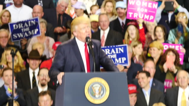 united states president donald trump speaks to 15,000 of his supporters about taxes and draining the swamp during a massive campaign rally style stop... - sumpf stock-videos und b-roll-filmmaterial
