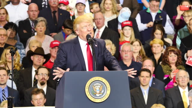 united states president donald trump speaks to 15000 of his supporters about taxes and draining the swamp during a massive campaign rally style stop... - politisk sammankomst bildbanksvideor och videomaterial från bakom kulisserna