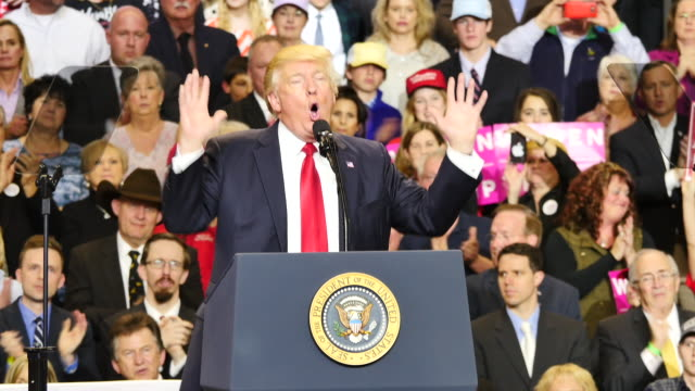 united states president donald trump speaks to 15,000 of his supporters about patriotism and god during a massive campaign rally style stop at... - speech点の映像素材/bロール