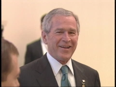 united states president george w. bush arrives at a meeting during the g-8 summit in japan. - 2000s style stock videos & royalty-free footage