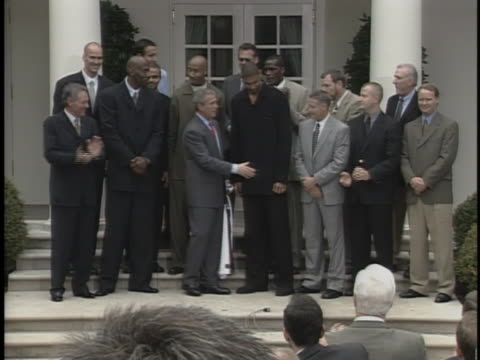 united states president george w bush laughs and jokes with members of the san antonio spurs basketball team - united states and (politics or government) stock videos & royalty-free footage