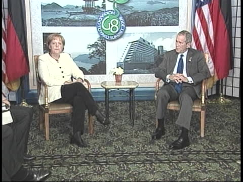 united states president george w. bush meets with german chancellor angela merkel during the the 2008 g8 summit in japan. - united states and (politics or government)点の映像素材/bロール