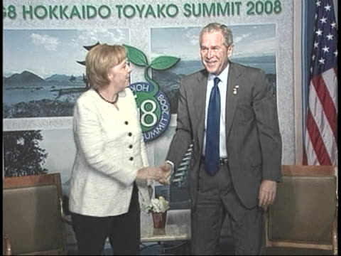 united states president george w. bush shakes hands with german chancellor angela merkel during the the 2008 g8 summit in japan. - demokrati bildbanksvideor och videomaterial från bakom kulisserna