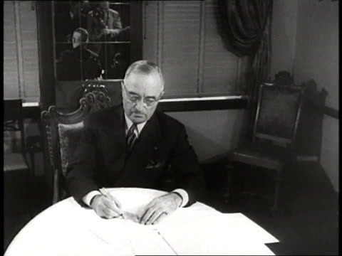 united states president harry s. truman signs the truman doctrine in 1947. - harry truman stock videos & royalty-free footage