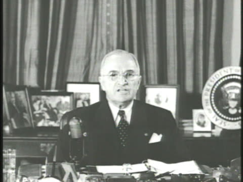 united states president harry s. truman sitting at desk in office speaking about the korean war, '... running a grave risk of starting a general... - korean war stock videos & royalty-free footage