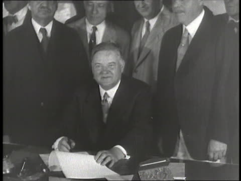 vídeos de stock, filmes e b-roll de united states president herbert hoover signs a piece of legislation and goes fly fishing in river - legislação