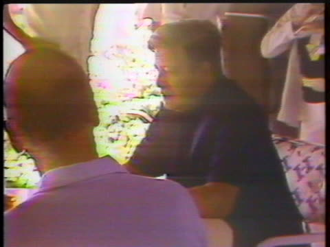 united states president jimmy carter james callaghan helmut schmidt and destaing valery giscard meet under a thatched roof at the guadeloupe summit - strohdach stock-videos und b-roll-filmmaterial