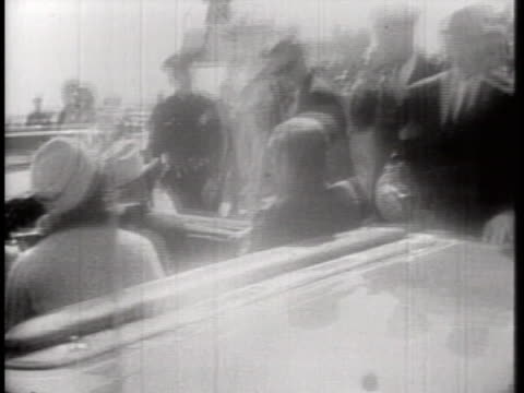 united states president john f. kennedy and mrs. kennedy ride in a convertible as part of a motorcade in dallas, texas. - jackie kennedy stock videos & royalty-free footage