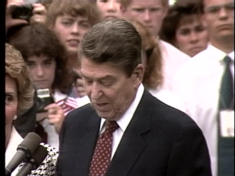 united states president ronald reagan delivers a speech before leaving for an economic summit in venice, italy. - 40 seconds or greater stock-videos und b-roll-filmmaterial