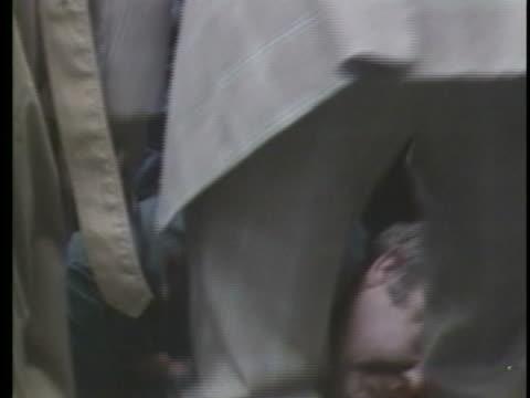 vidéos et rushes de united states press secretary james brady lies on a sidewalk after being shot during an assassination attempt against united states president ronald... - meurtre