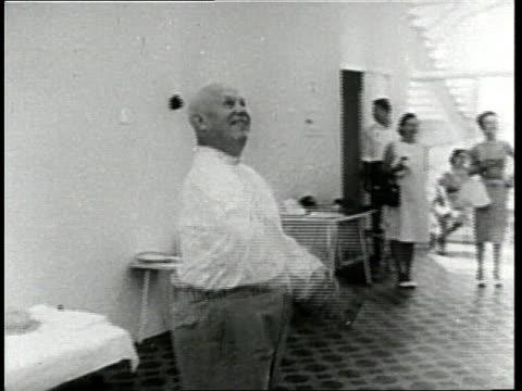 United States Secretary of State Dean Rusk plays badminton with Soviet Premier Nikita Khrushchev