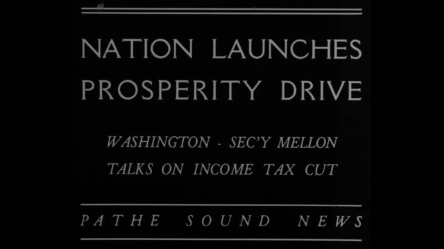 United States Secretary of the Treasury Andrew Mellon reads statement / Note exact day not known