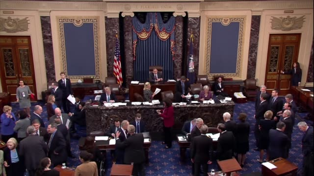 united states senators are seen shaking hands and hugging during a voice vote on a federal judge before departing washington to campaign for the 2018... - united states congress stock videos & royalty-free footage