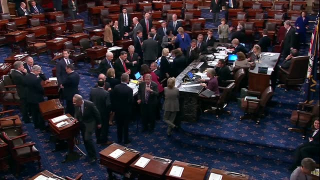 united states senators are seen shaking hands and hugging during a roll call vote on a federal judge before departing washington to campaign for the... - united states senate stock videos & royalty-free footage