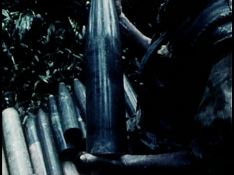 united states soldiers with captured weapons and rice stockpiles / south vietnam - 南ベトナム点の映像素材/bロール