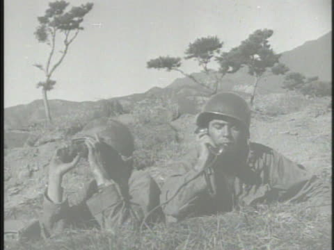 united states tank regiment firing on hills mountains in taegu various marines soldiers in bushes one firing rocket launcher another resting w/ dirt... - regiment stock videos and b-roll footage