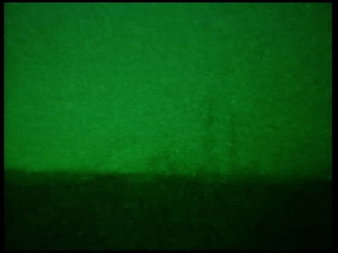 united states troops prepare for assault on fallujah; pool iraq: fallujah: ext/night green nightscope shotbombs exploding on skyline 00:00:13 - al fallujah video stock e b–roll