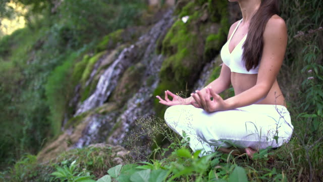 united with nature - lotus position stock videos & royalty-free footage