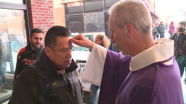 WGN Unity Lutheran Church offered to administer ashes that were mixed with glitter at the Berwyn red line CTA station in Chicago for Ash Wednesday on...