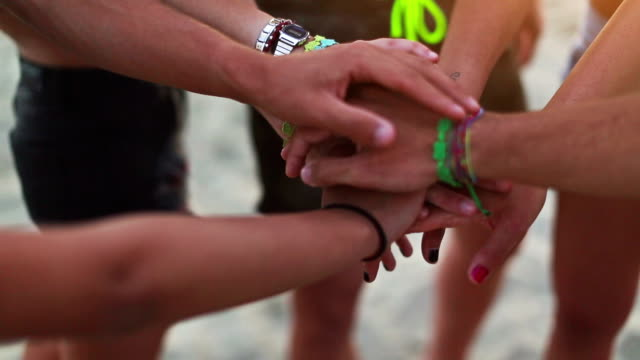 unity oath pile of hands on the beach - loyalty stock videos & royalty-free footage