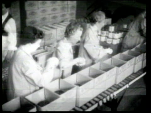 red cross volunteers pack boxes that will be sent to allied prisoners of war. - red cross stock videos & royalty-free footage