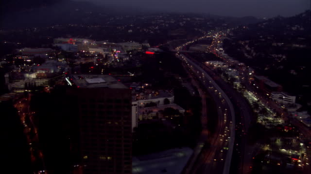aerial universal city at night, california, usa - universal city stock videos & royalty-free footage