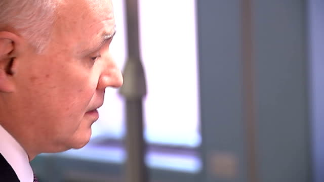 universal credit benefit system: iain duncan smith interview; england: london: hammersmith: int various shots of iain duncan smith mp visiting job... - mp stock-videos und b-roll-filmmaterial