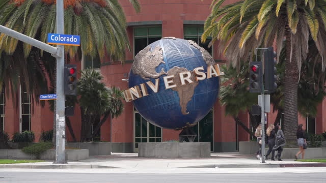 universal music group headquarters exterior, globe statue in santa monica, california, u.s., on friday, june 4, 2021. - street name sign stock videos & royalty-free footage