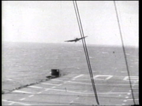 a helicopter attempts to rescue a naval aviator after an aborted attempt to land on a us aircraft carrier - aircraft carrier stock videos and b-roll footage
