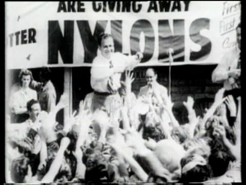 radio station distributes free nylons to a crowd of women. - stockings stock videos & royalty-free footage