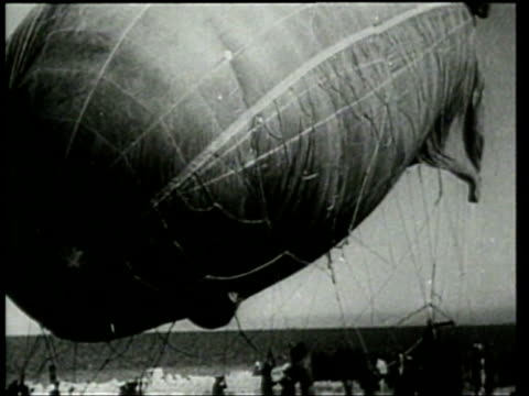 stockvideo's en b-roll-footage met aerial gunners destroy a blimp during a military exercise - 1920 1929