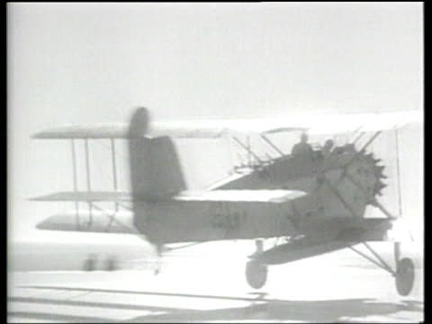an airplane launches a torpedo from the air where it strikes a ship. - torpedo stock videos & royalty-free footage