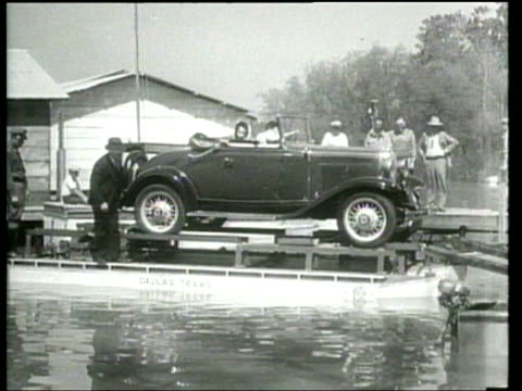 vídeos de stock e filmes b-roll de an automobilepowered pontoon boat called a flivver shows promise as a versatile autoboat - 1931