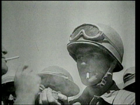 as allied civilian and military leaders meet and plan allied soldiers attack and win in north africa and italy - ニュース映画点の映像素材/bロール