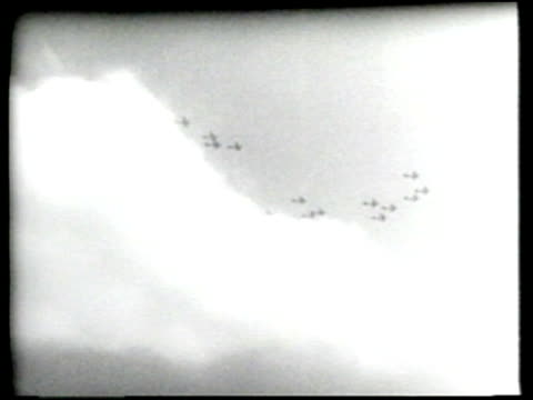 b17 flying fortresses attack nazi industrial areas in hamburg germany and return with damages and casualties after luftwaffe attacks - ニュース映画点の映像素材/bロール