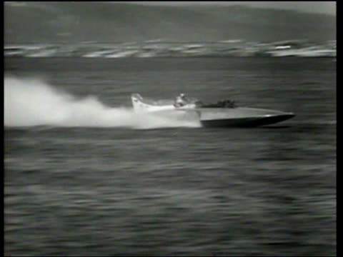 vídeos y material grabado en eventos de stock de bill muncey drives miss thriftway to an unlimited hydroplane championship on lake washington at seattle as donald campbell sets a world water record... - hidroplano