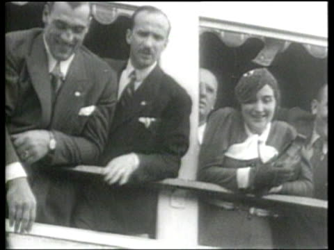 boxing champion primo carnera returns to welcoming crowds in italy - primo carnera stock videos and b-roll footage