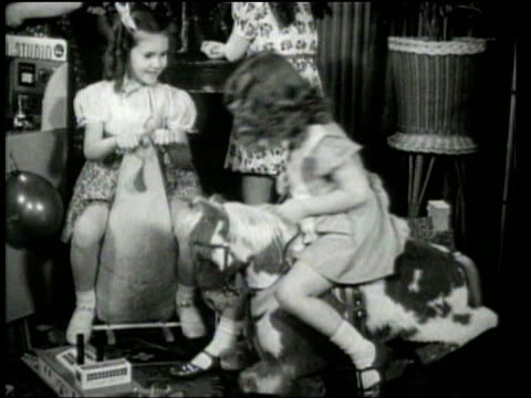 children preview christmas toys at a new york city show. - 1939 stock-videos und b-roll-filmmaterial