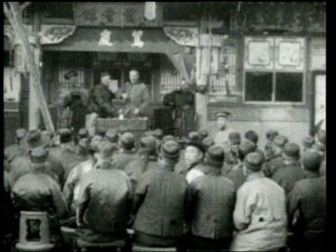 Chinese merchants protest the Nationalist Government's inefficiency to prevent looting by Chinese rebels