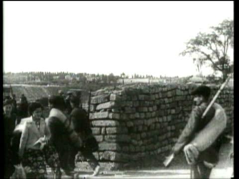 vídeos de stock e filmes b-roll de citizens of madrid, spain live with the ramifications of war. - guerra civil