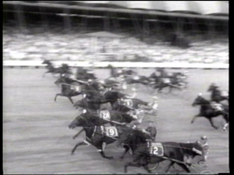 Driver Harry Harvey drives 'Helicopter to a win in the third heat and wins the the Hambletonian