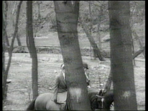 Eleanor Roosevelt rides her horse Patches as media members watch