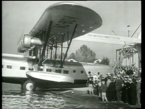 first lady lou henry hoover christens a new pan american airline clipper passenger airplane. - first lady stock videos & royalty-free footage