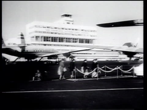 Friends wave as Japanese women visitors board a Pan American passenger plane for their return to Japan